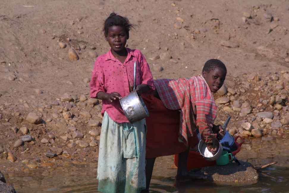 Children washing up in the Kafue River
